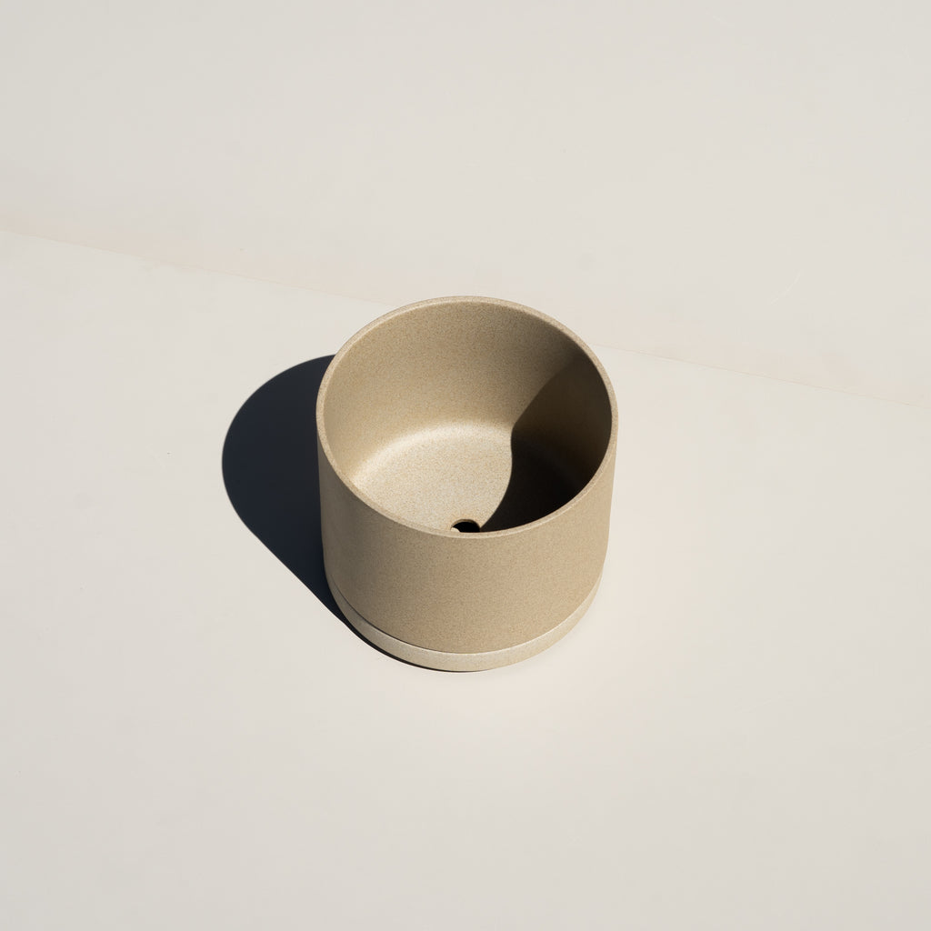 The Hasami Porcelain Planter in natural has a drainage hole.