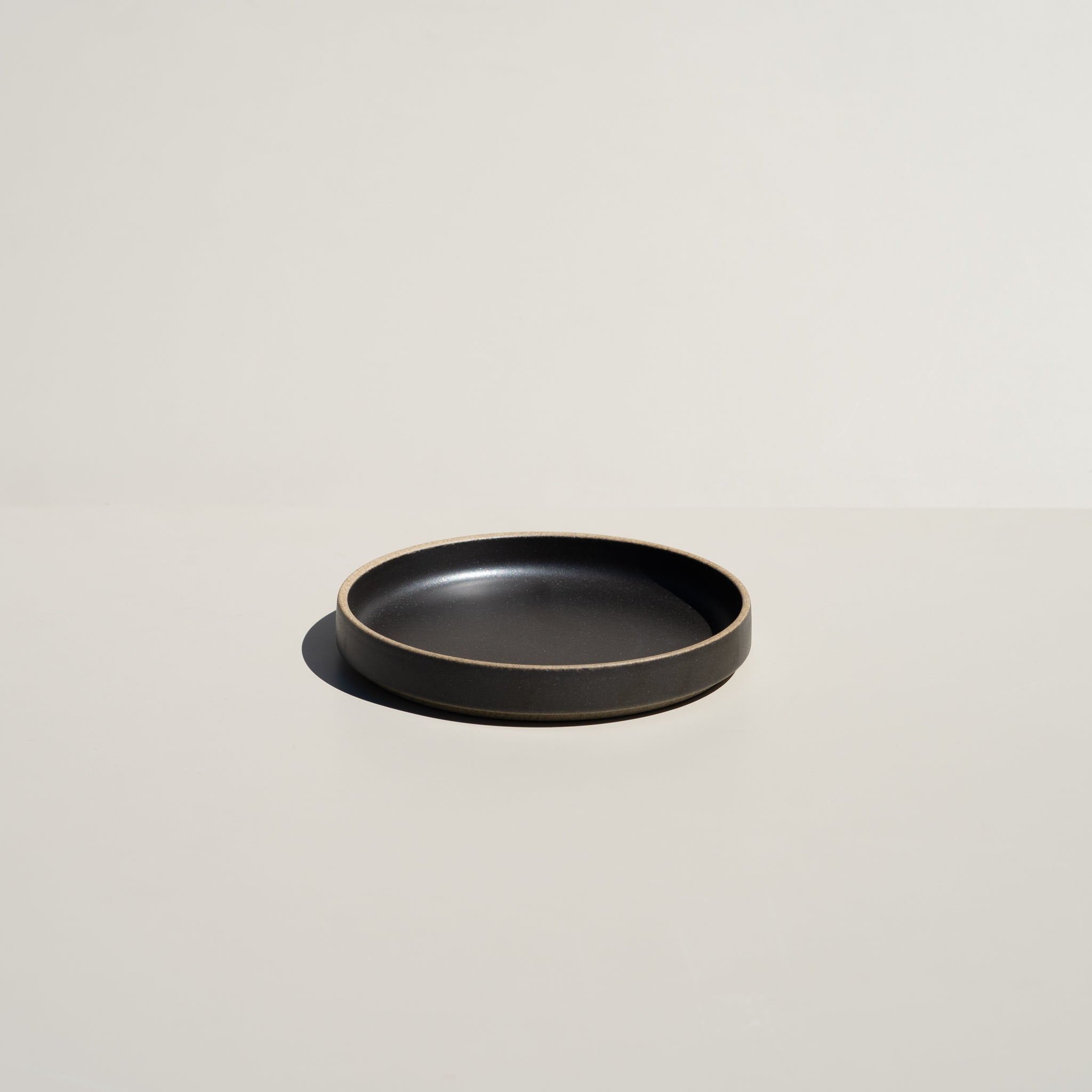 "Hasami Porcelain 5.5/8"" plate in satin black finish."