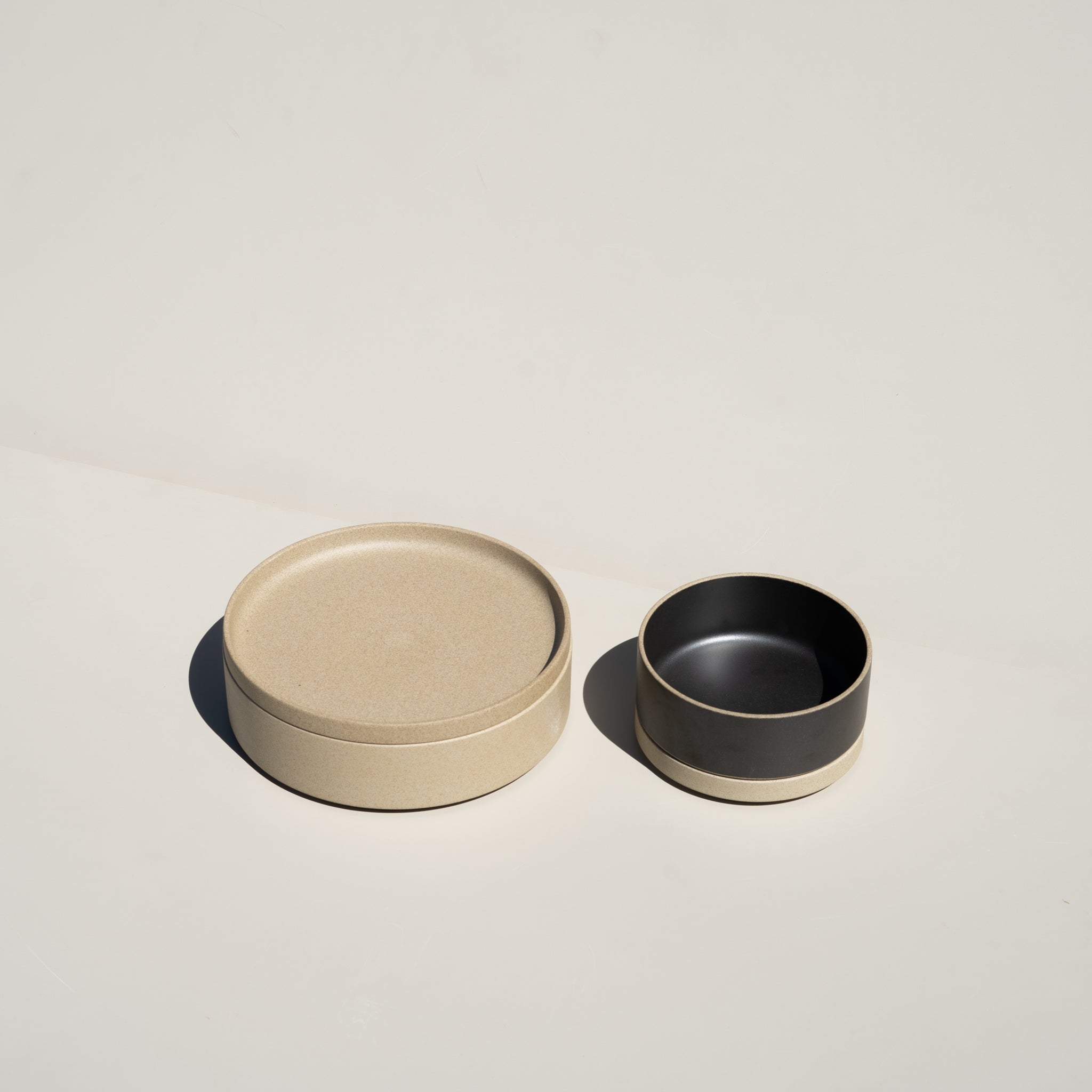 "The Hasami Porcelain 5.5/8"" plate in natural has a stackable design."