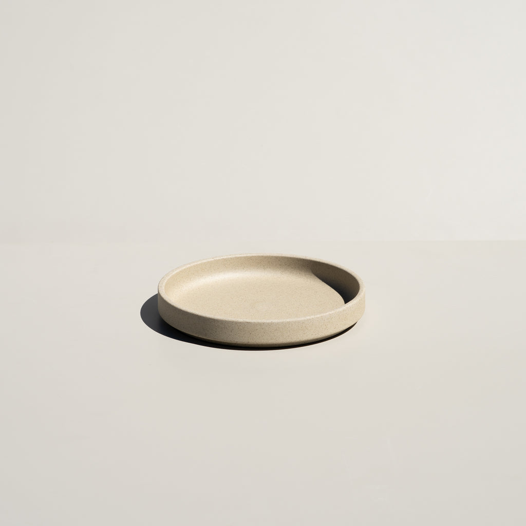 "Hasami Porcelain 5.5/8"" plate in natural finish."