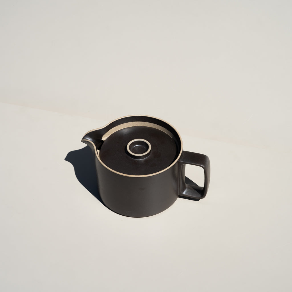 The Teapot in black from Hasami Porcelain has a stackable design.