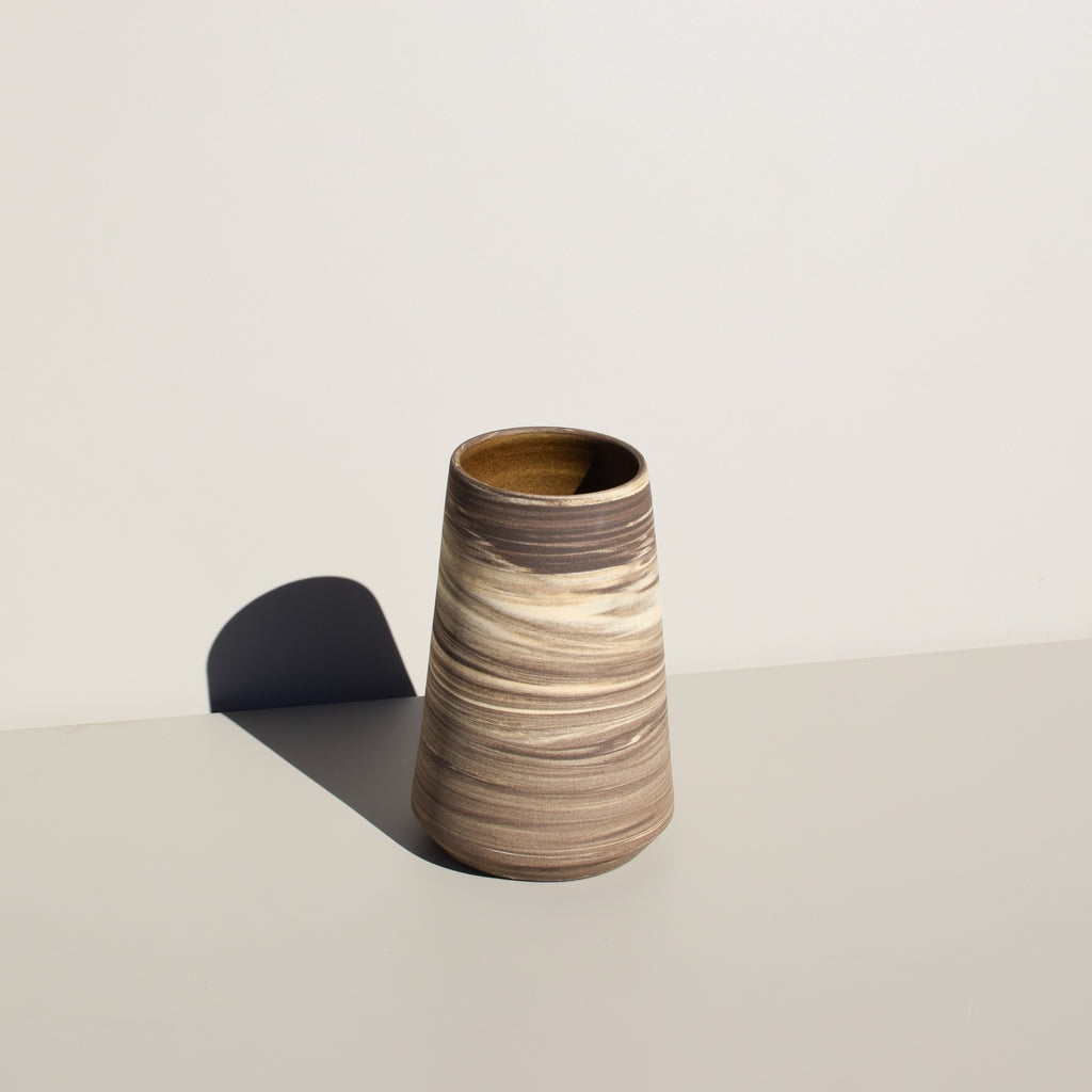 A marbled ceramic vase by IW Ceramics available at Commonplace.