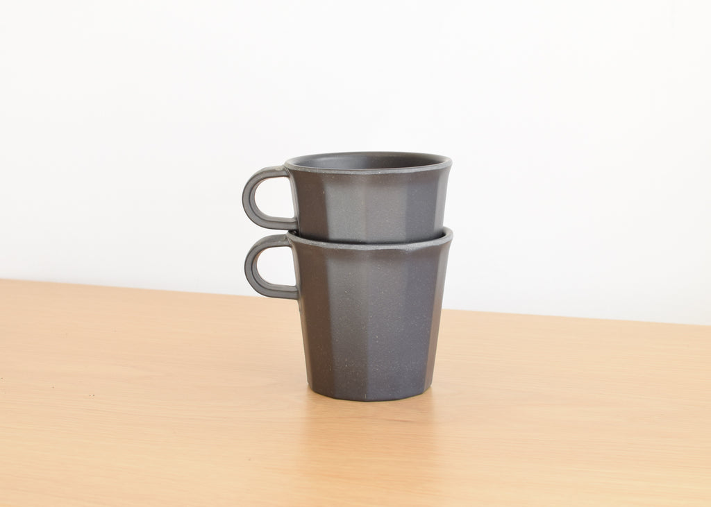 The Kinto stackable Alfresco Mug in black, sold in a set of two.