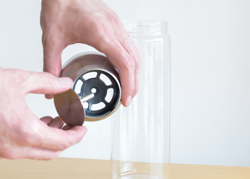 The Kinto Capsule Water Carafe from Commonplace design shop, with stainless steel top.
