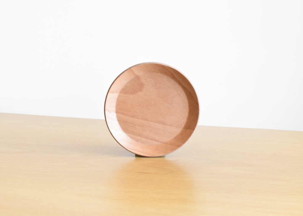In teak and birch, the Cast Coaster by Kinto Japan.