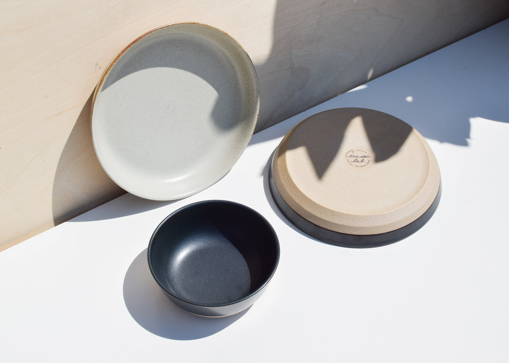 The Kinto Ceramic Lab Deep Plate in black from Commonplace with matching bowl.