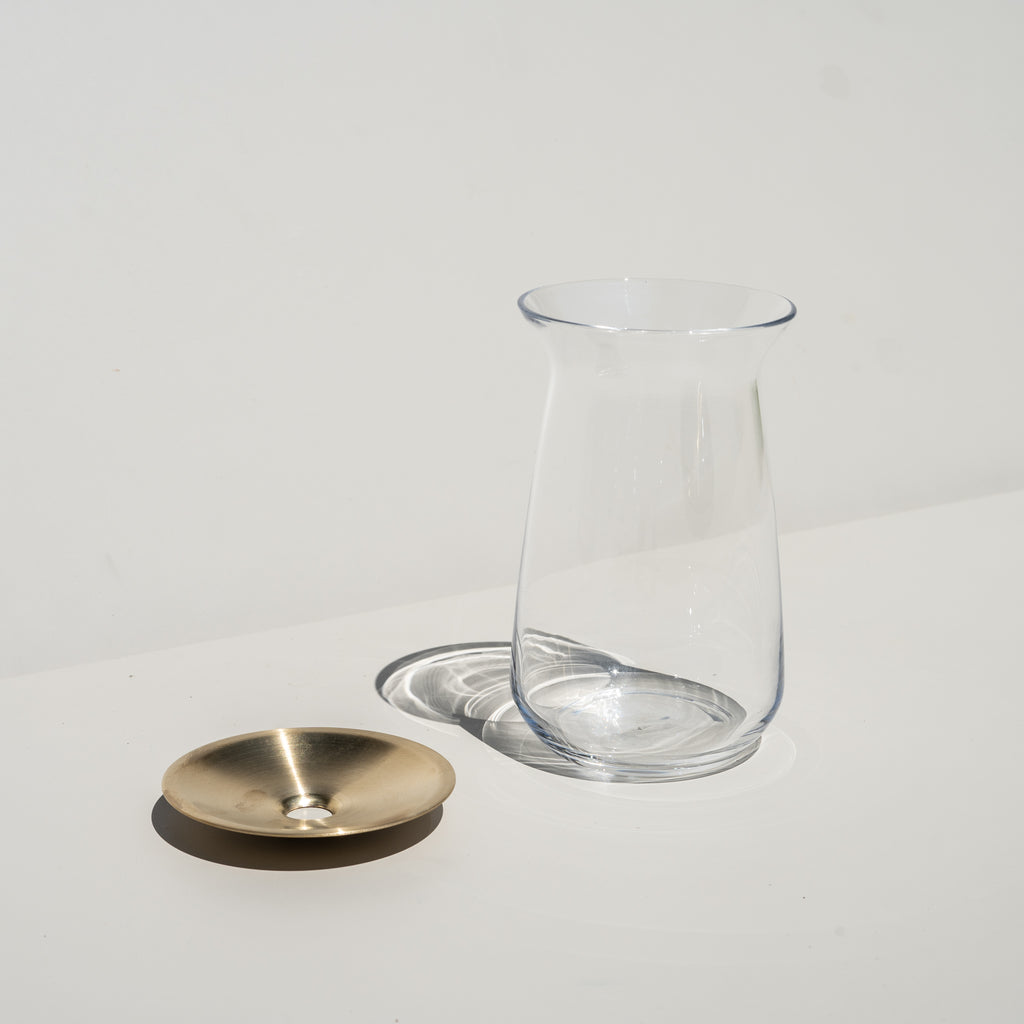 The Kinto Luna Vase, made of glass and brass.