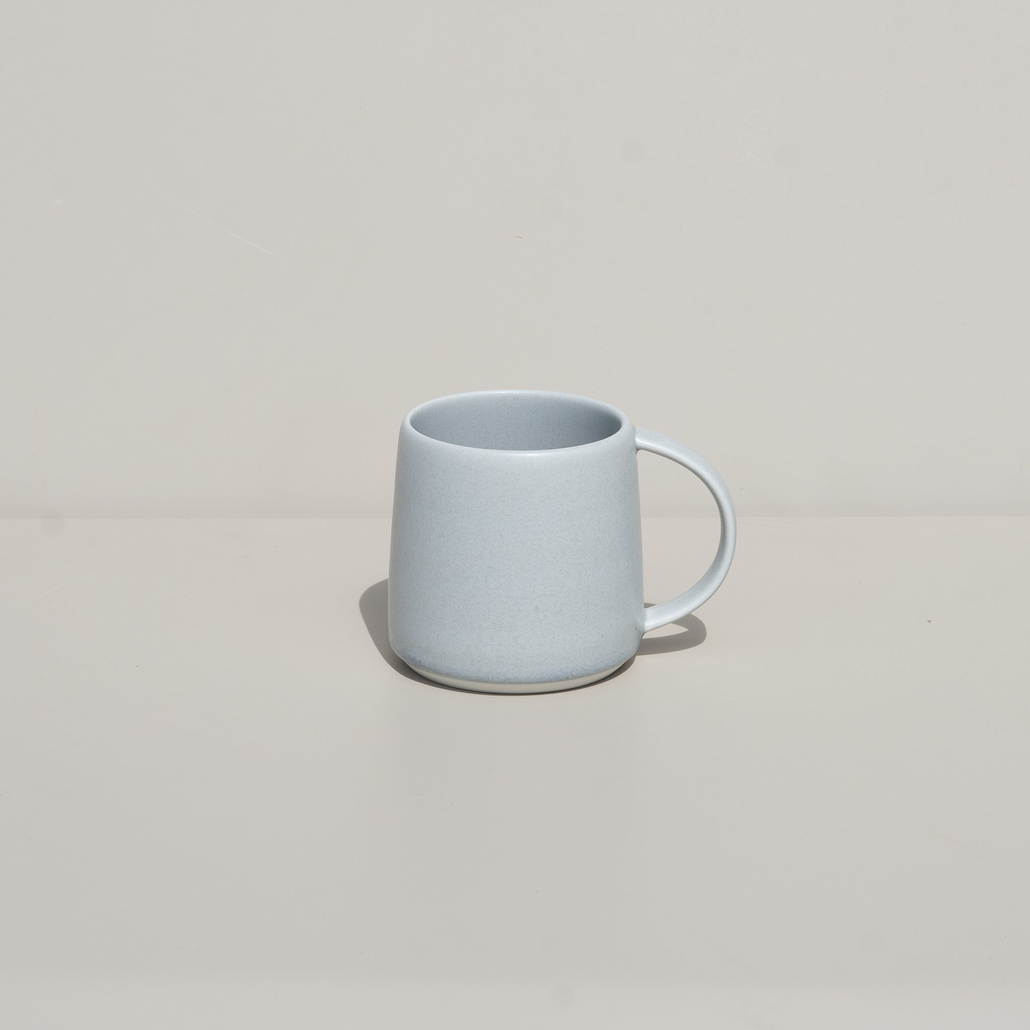 The Ripple Mug from Kinto in soft gray.