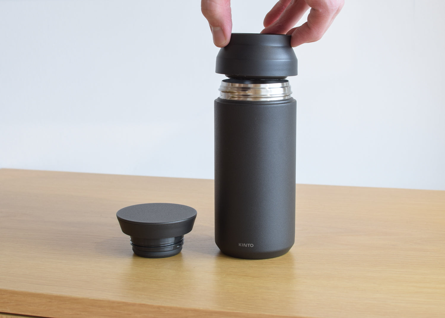 The Kinto 350 ml Travel Tumbler in black with double walled interior.