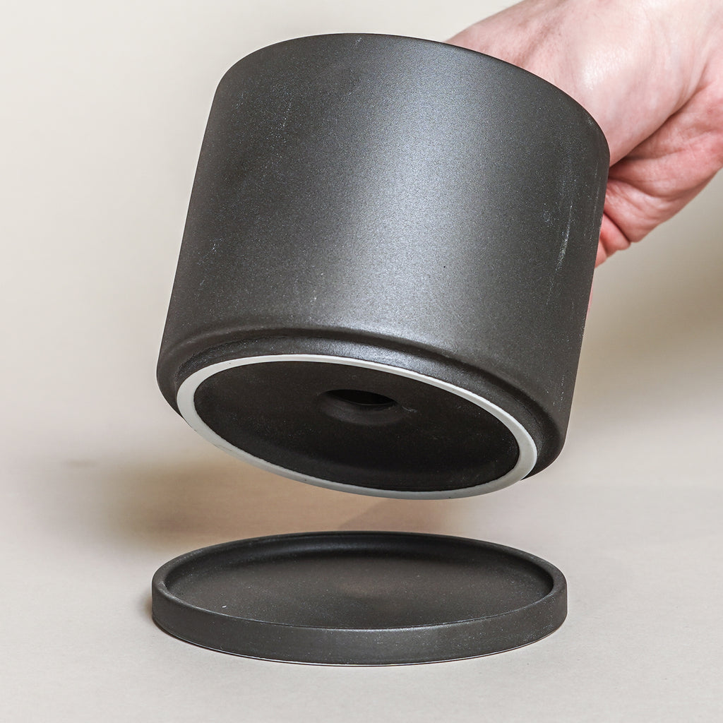 A porcelain planter, the Plant Pot 191 in 105mm size from Kinto in dark grey.