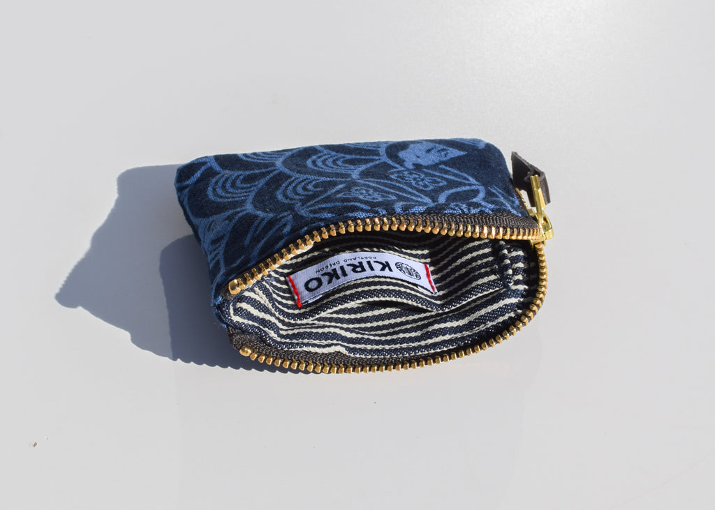 The Zipper Wallet in Indigo Large Multi Pattern with interior card pocket..
