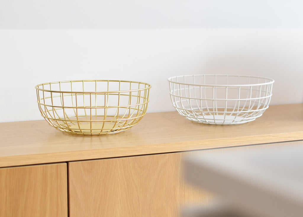 The Wire Bowl in brass and white from Danish design brand Menu, designed by Norm Architects.