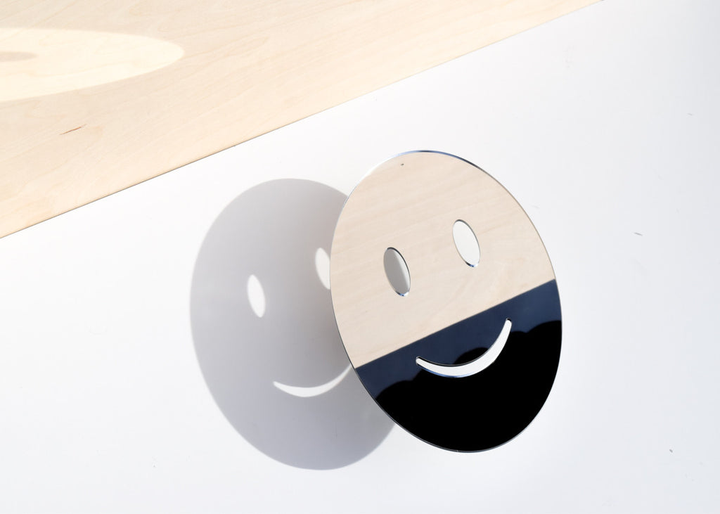 The Smile Emoji Mirror in the sun.