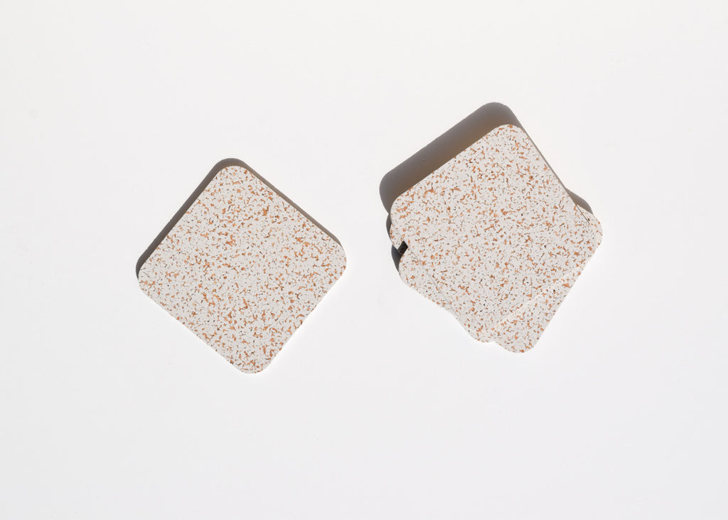 The Most Modest cork and rubber Coasters in white.