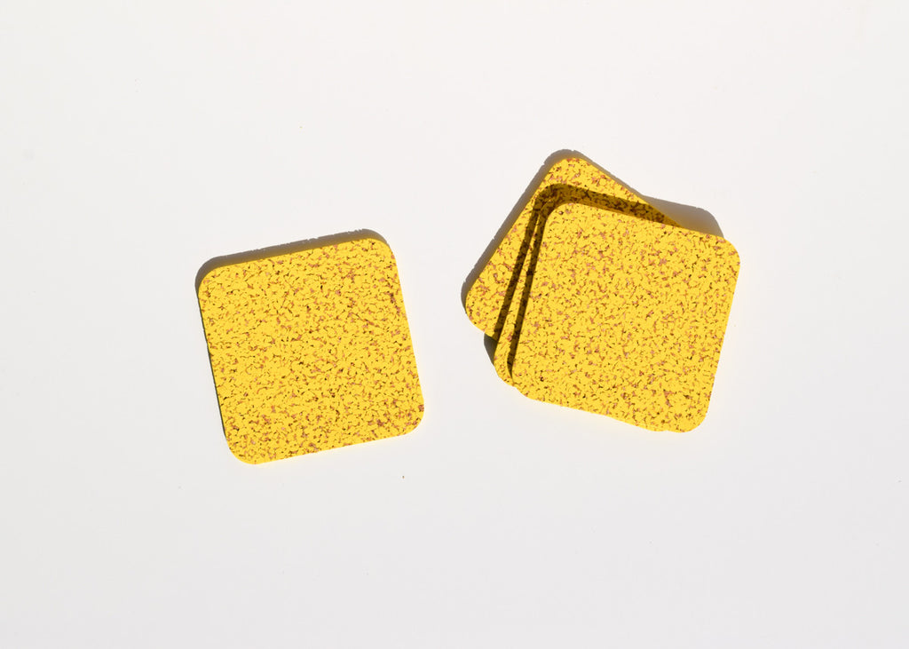 The Most Modest cork and rubber Coasters in yellow.