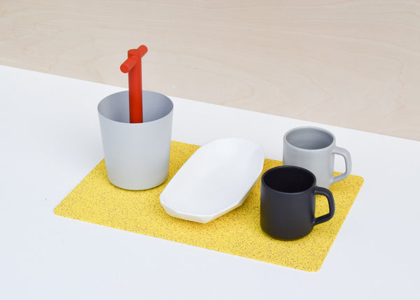 The Most Modest Large Rectangle Rubber Mat in yellow in use as a placemat.