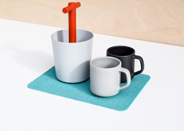 The Most Modest Rectangle Rubber Mat in teal in use as a trivet.