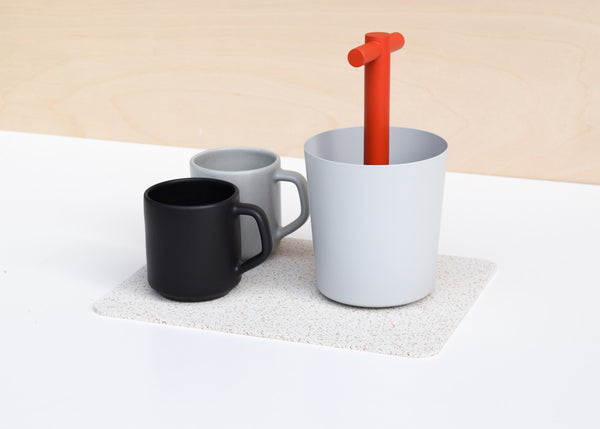 The Most Modest Rectangle Rubber Mat in white in use as a trivet.
