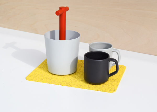 The Most Modest Rectangle Rubber Mat in yellow in use as a trivet.