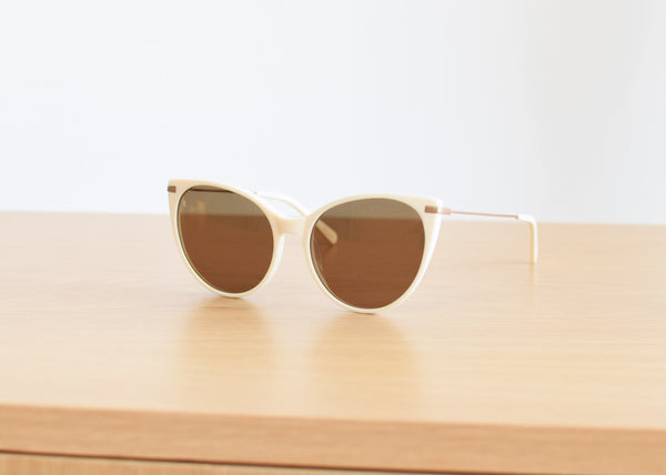Raen Birch sunglasses in Bone & Rose Gold from Commonplace.