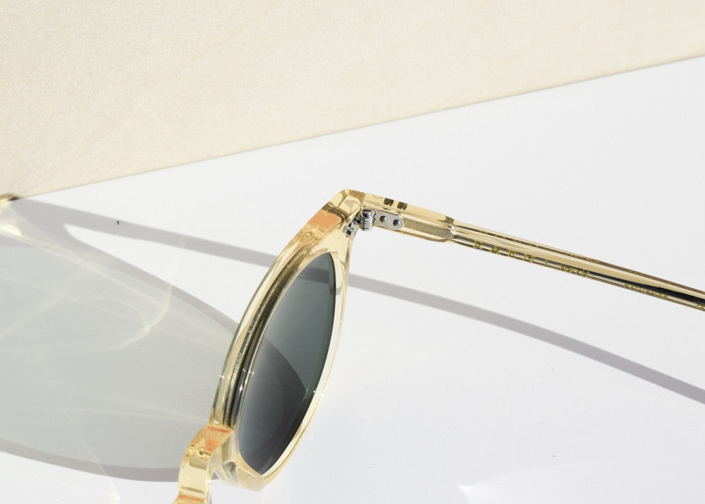 The Raen Norie cat-eye sunglasses in champagne crystal with polarized green lenses.
