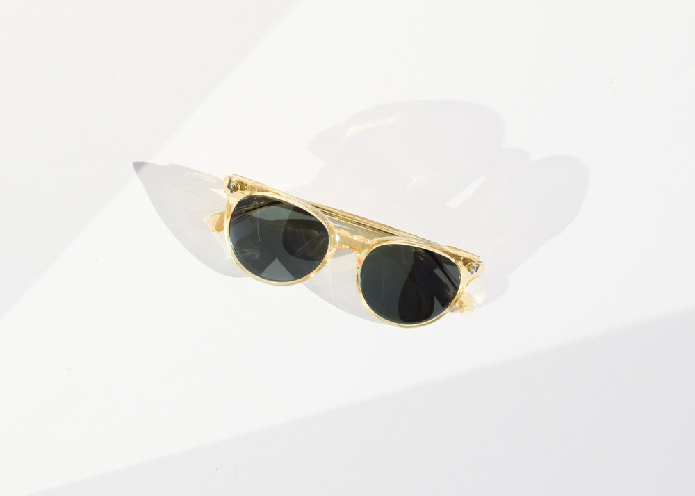 The Raen Norie cat-eye sunglasses in champagne crystal with strong hardware.