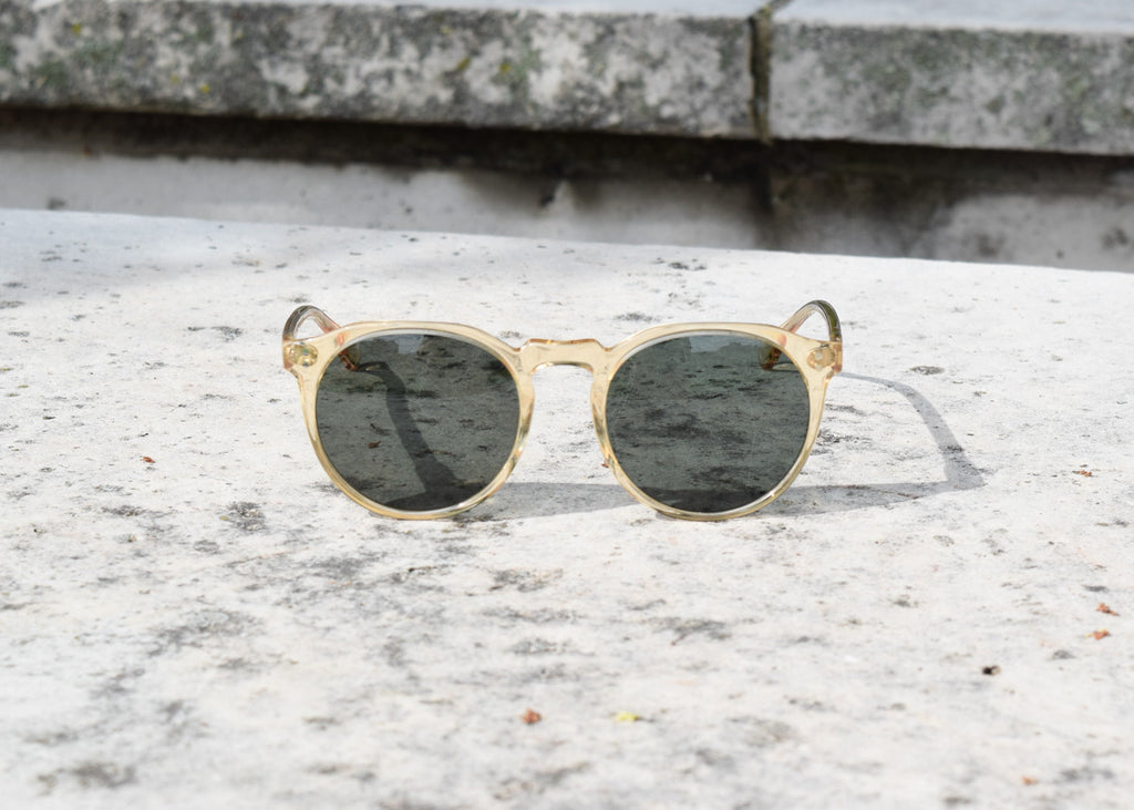 The Raen Remmy classic sunglasses in champagne crystal with polarized lenses from the front and outside.