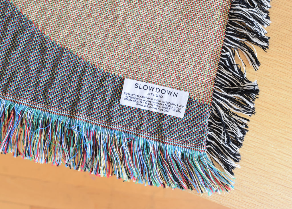 The Holloway Throw by Slowdown Studio is made in the USA.