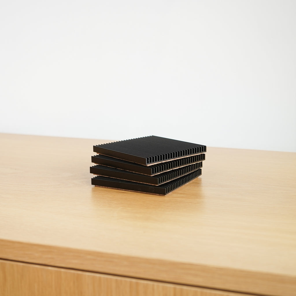 Fin Coasters in black by Souda at Commonplace design shop in Milwaukee, WI.