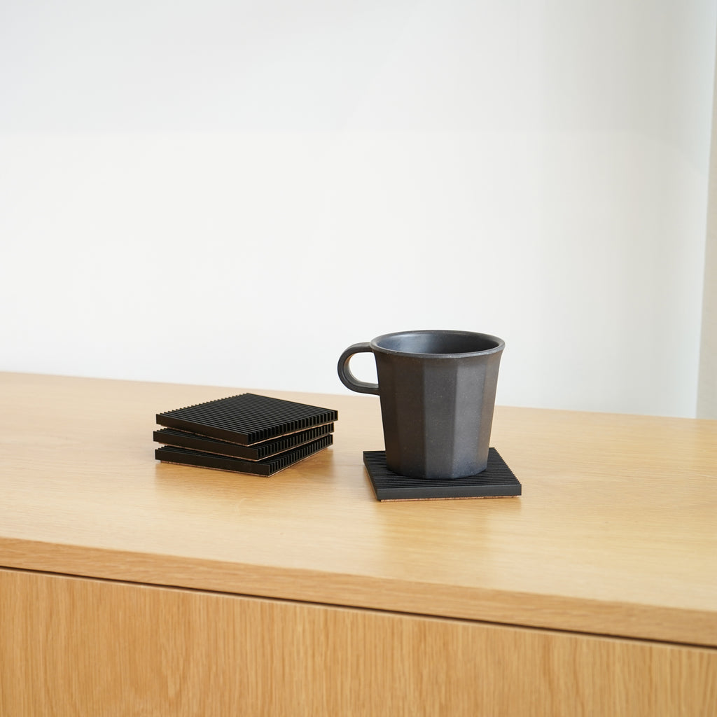 Black Fin Coasters by Souda in use at Commonplace.