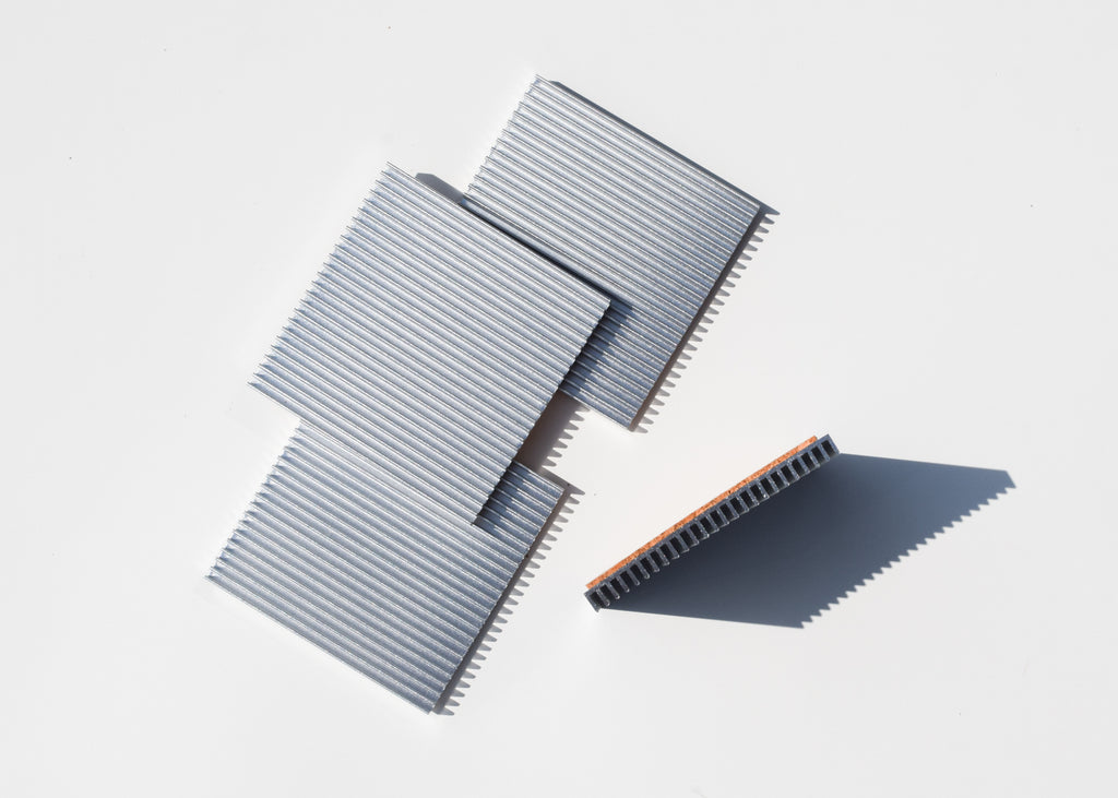 Souda's Fin Coasters are a contemporary coaster option designed to be displayed.