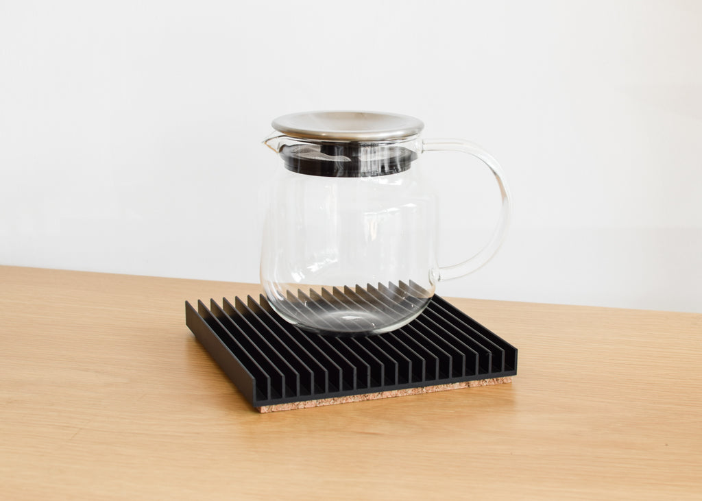 The Fin Trivet in black by Souda, and available at Commonplace design shop in Milwaukee, Wisconsin.