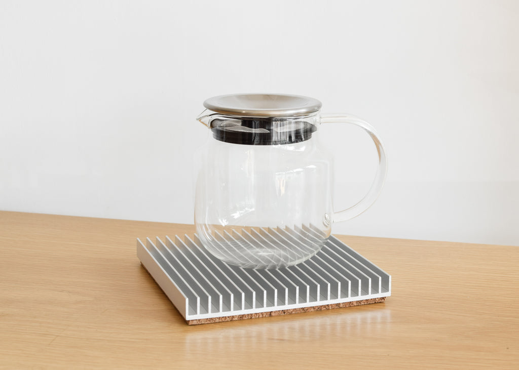 Souda's Fin Trivet in silver has a protective cork bottom.