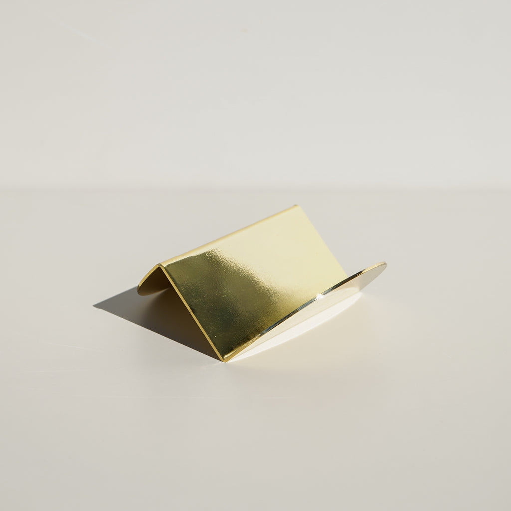 The Wave Business Card Holder in brass from Brooklyn based design studio Souda.