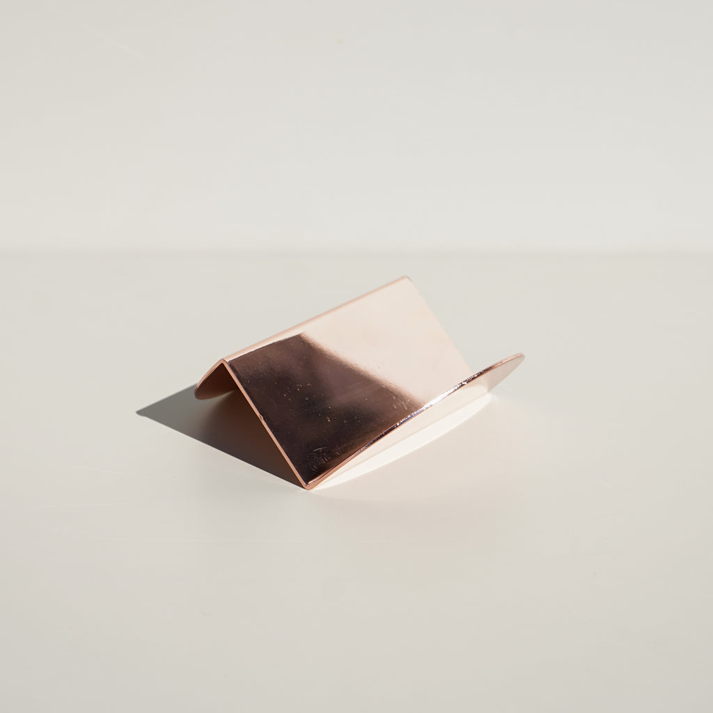 The Wave Business Card Holder in copper from Brooklyn based design studio Souda.