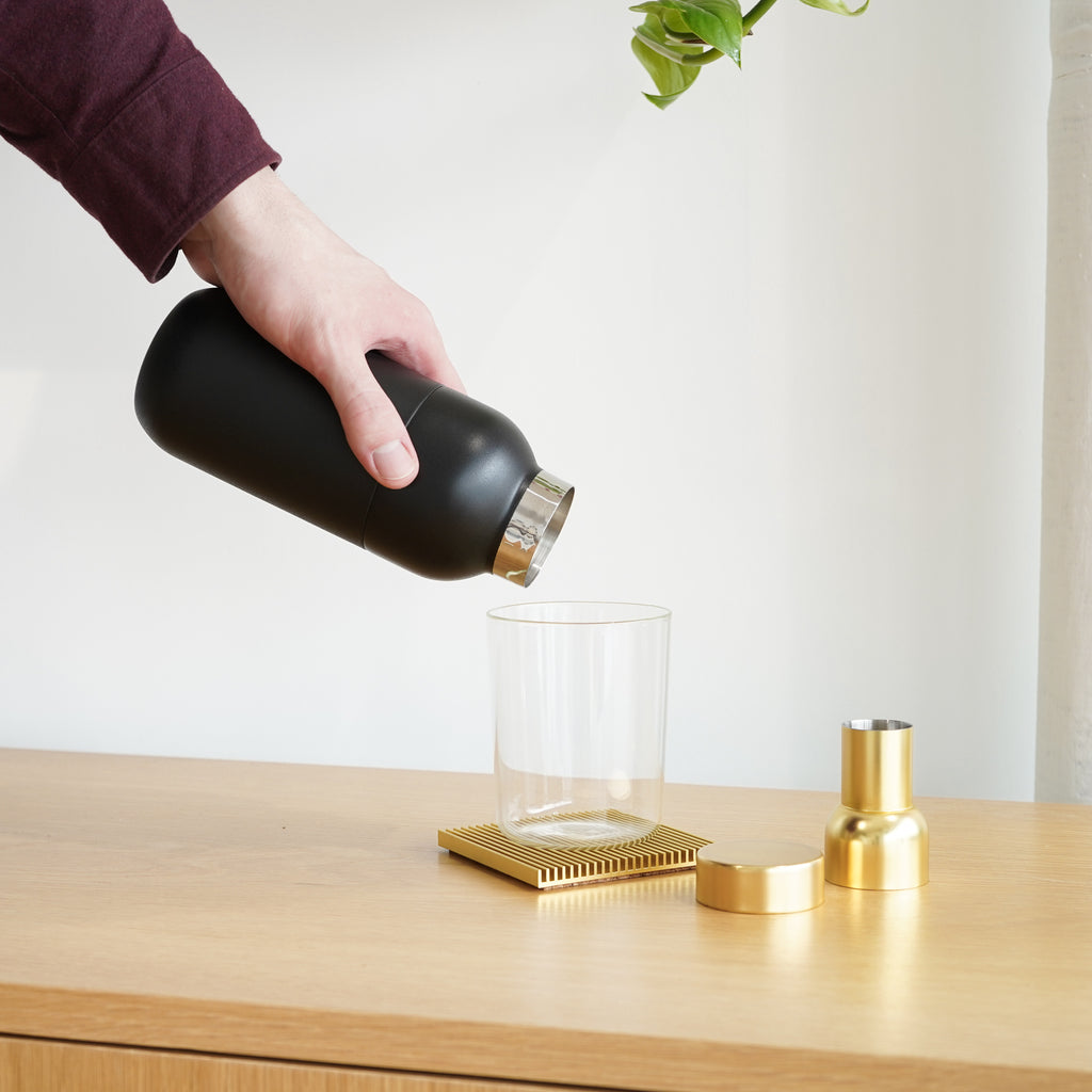 The Collar Cocktail Shaker from Stelton with matching measuring cup.