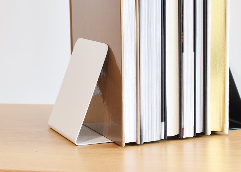 The This That powder coated steel Angled Bookend in gloss white from Commonplace.