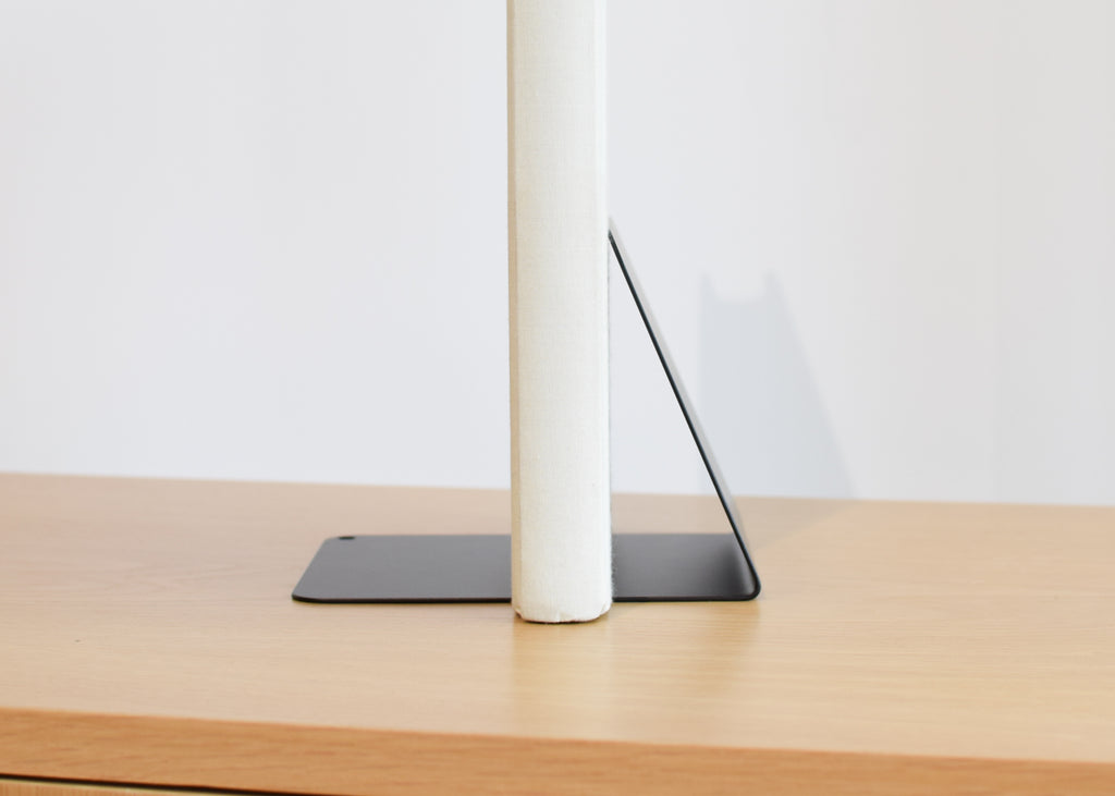 This That's Angled Bookend is a design object that features a single horizontal point of contact to hold books.
