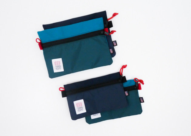 Topo Designs Accessory Bags shown in all sizes and colors.