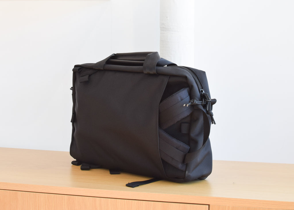 Topo Designs Commuter Briefcase in Ballistic Black designed with three carry options.
