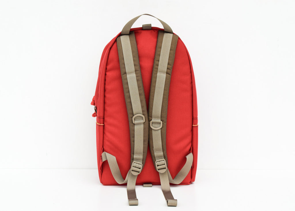 The Topo Designs Daypack in red from the back.