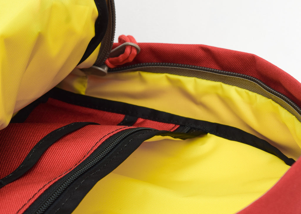 The Topo Designs Daypack in red with laptop sleeve.