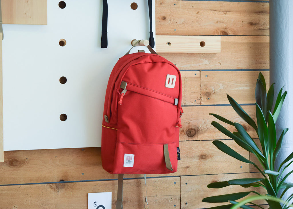 The Topo Designs Daypack in red in Commonplace.