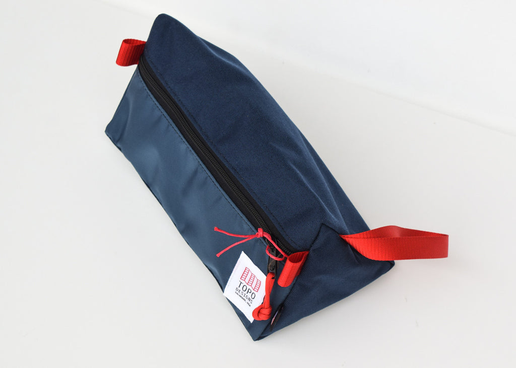 The Topo Designs Dopp Kit in navy from above.