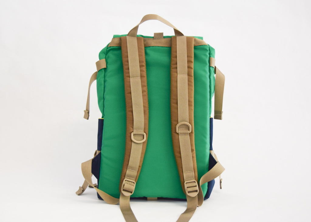 Topo Designs Rover Pack in kelly/navy with padded shoulder straps.