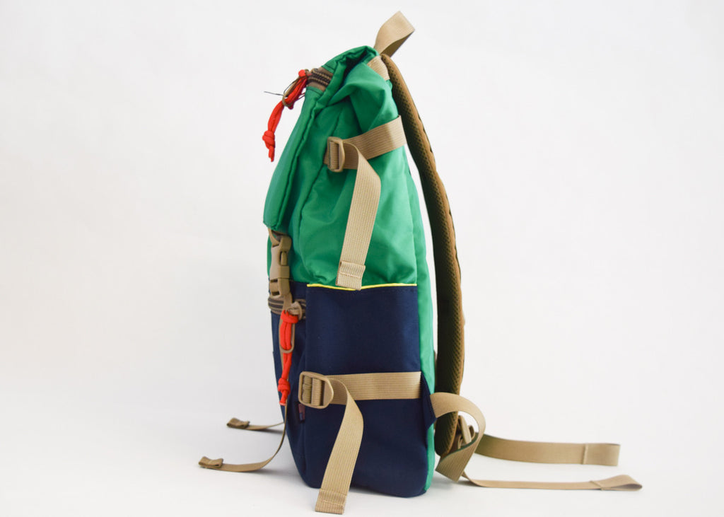 Topo Designs Rover Pack in kelly/navy with side pockets.