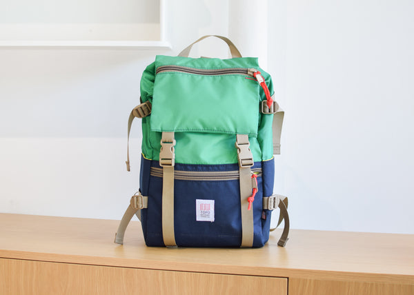 The Topo Designs Rover Pack in kelly/navy from Commonplace design shop.
