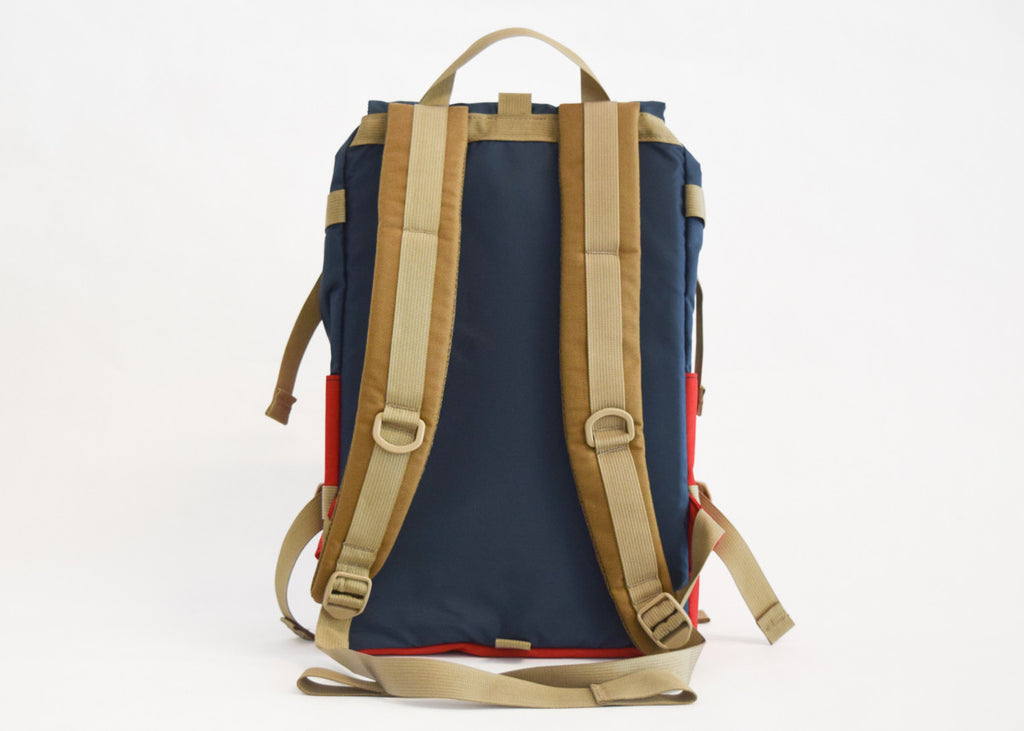Topo Designs Rover Pack in navy/red with padded shoulder straps.