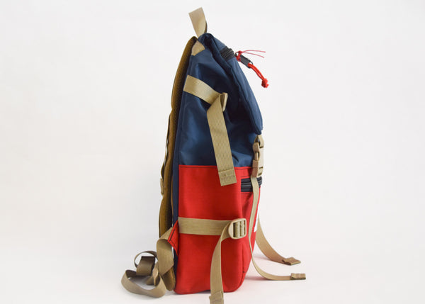 Topo Designs Rover Pack in navy/red with side pockets.