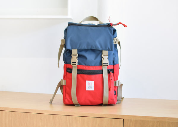 The Topo Designs Rover Pack in navy/red from Commonplace design shop.